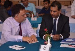 Prof. Jones Mathew with an industry expert during Rendezvous 2015,